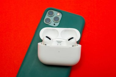 New Apple Computers AirPods Pro headphones on the iPhone 11 Pro