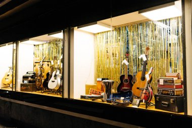 large showcase musical store showcase selling pianos guitars