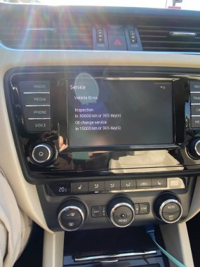 Modern Skoda car dashboard with Service information to be performed in 15000 kilometers or 365 days