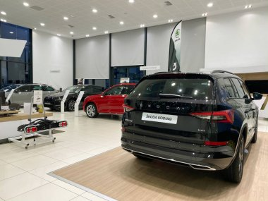 Paris, France - Oct 25, 2019: Wide angle view of car dealership showroom interior with multiple Skoda Cars inside and focus on black Skoda Kodiaq 4x4 SUV stock vector