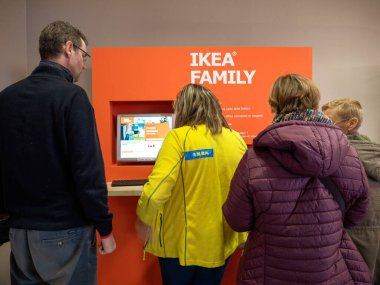 Rear view of people in front of the digital kiosk at IKEA store