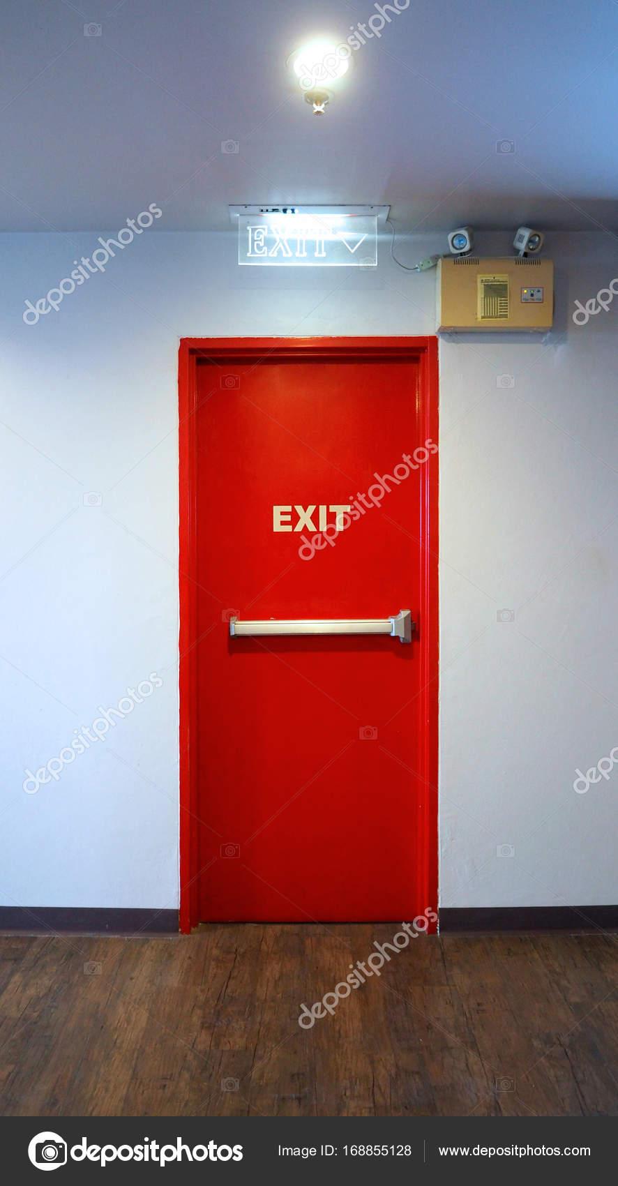 Emergency fire exit door red color. u2014 Stock Photo & Emergency fire exit door red color. u2014 Stock Photo © gnepphoto #168855128