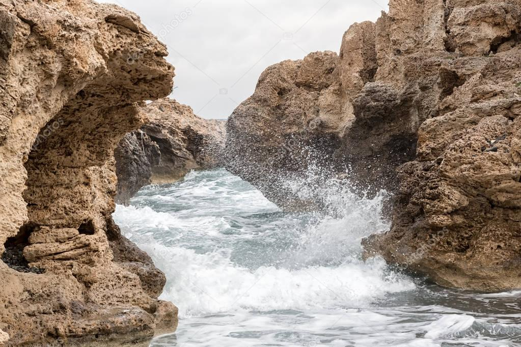 Mediterranean Sea waves breaking rocky coastline of Cyprus island