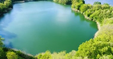 Lake surrounded by forest with air