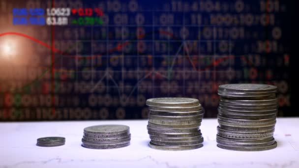 Graph and rows of coins for finance and business concept
