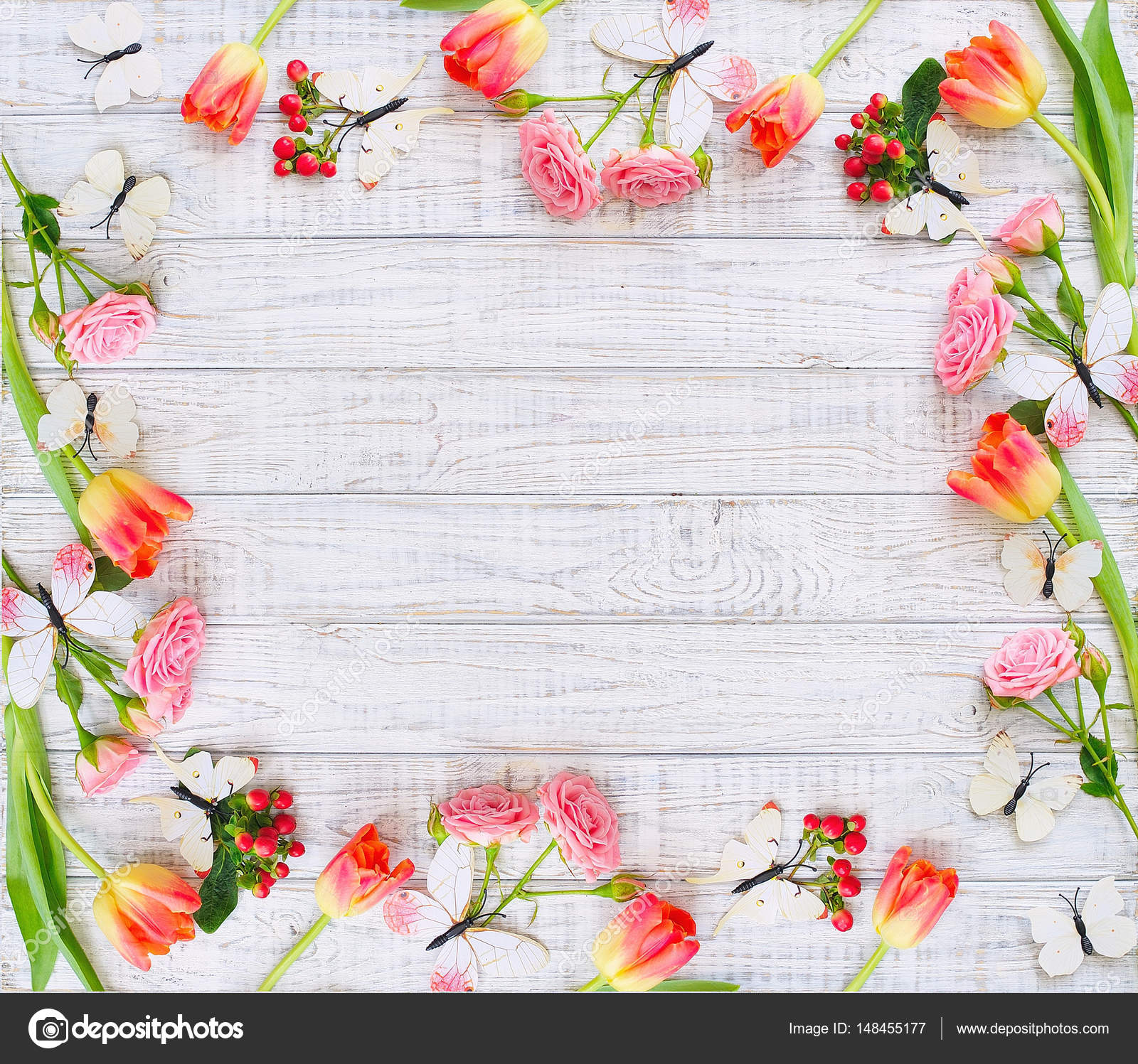 Floral Frame With Spring Flowers And Butterflies Stock Photo