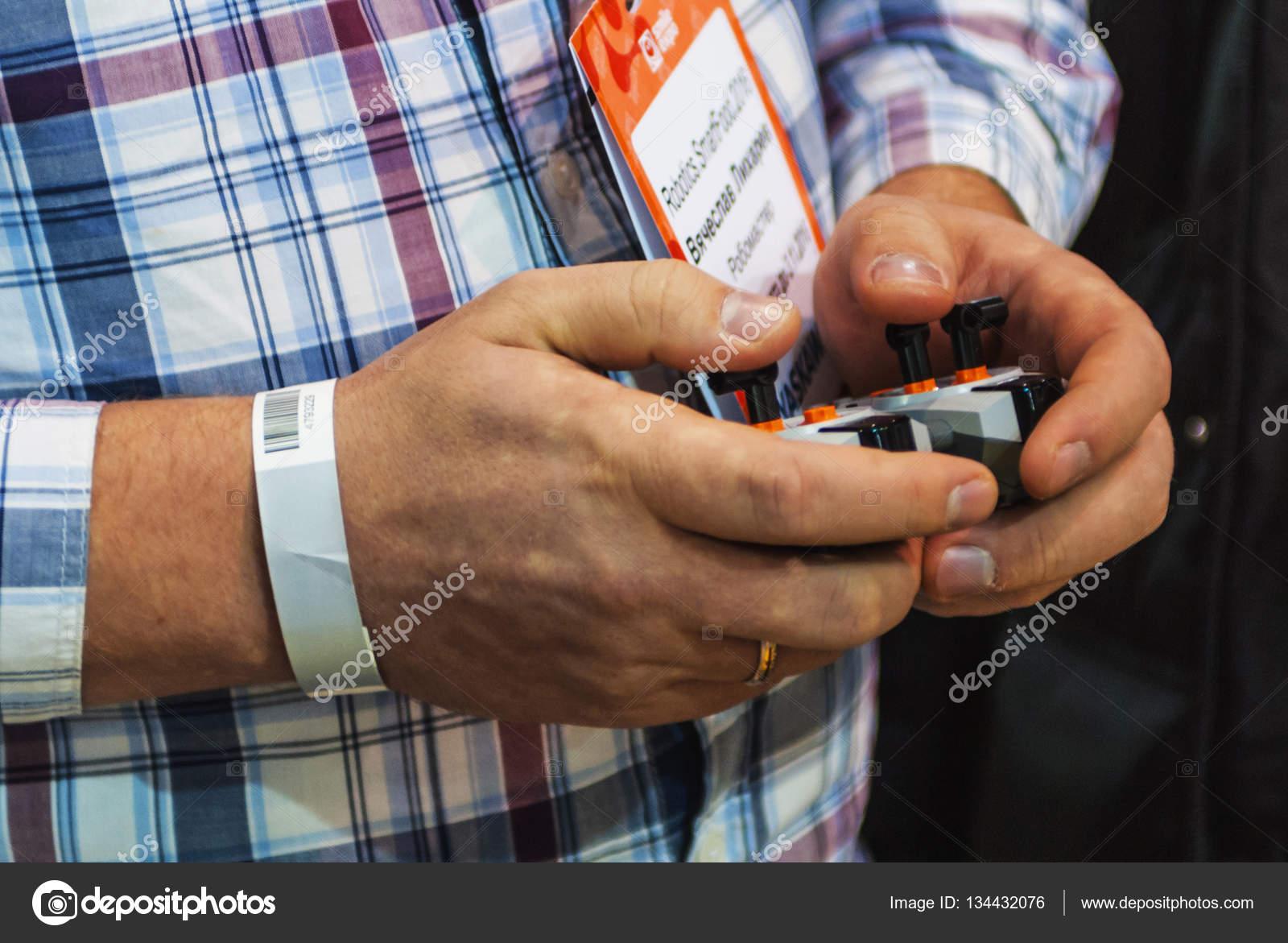 Man is holding joystick on Robotics Expo 2016 – Stock Editorial
