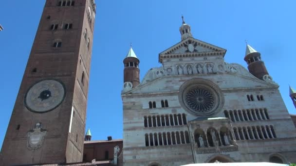 CREMONA, ITALY - circa 2016: Cremona Cathedral, consecrated in 1196, was built in Romanesque style and later extended with Gothic, Renaissance and Baroque elements. 50 fps, real time