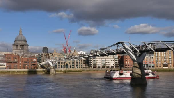 LONDON, UK - DECEMBER 20, 2016: People walking over Millennium bridge. Its a suspension bridge with a total length of 370 metres (1,214 ft) and a width of 4 metres (13 ft).ultra hd 4k,real time.