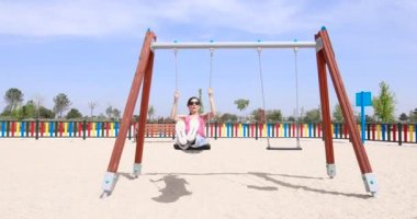 Woman swinging at playground park