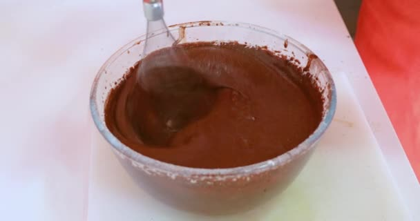 whipping chocolate or cocoa cream in glass bowl with electric mixer, to cook a sponge cake