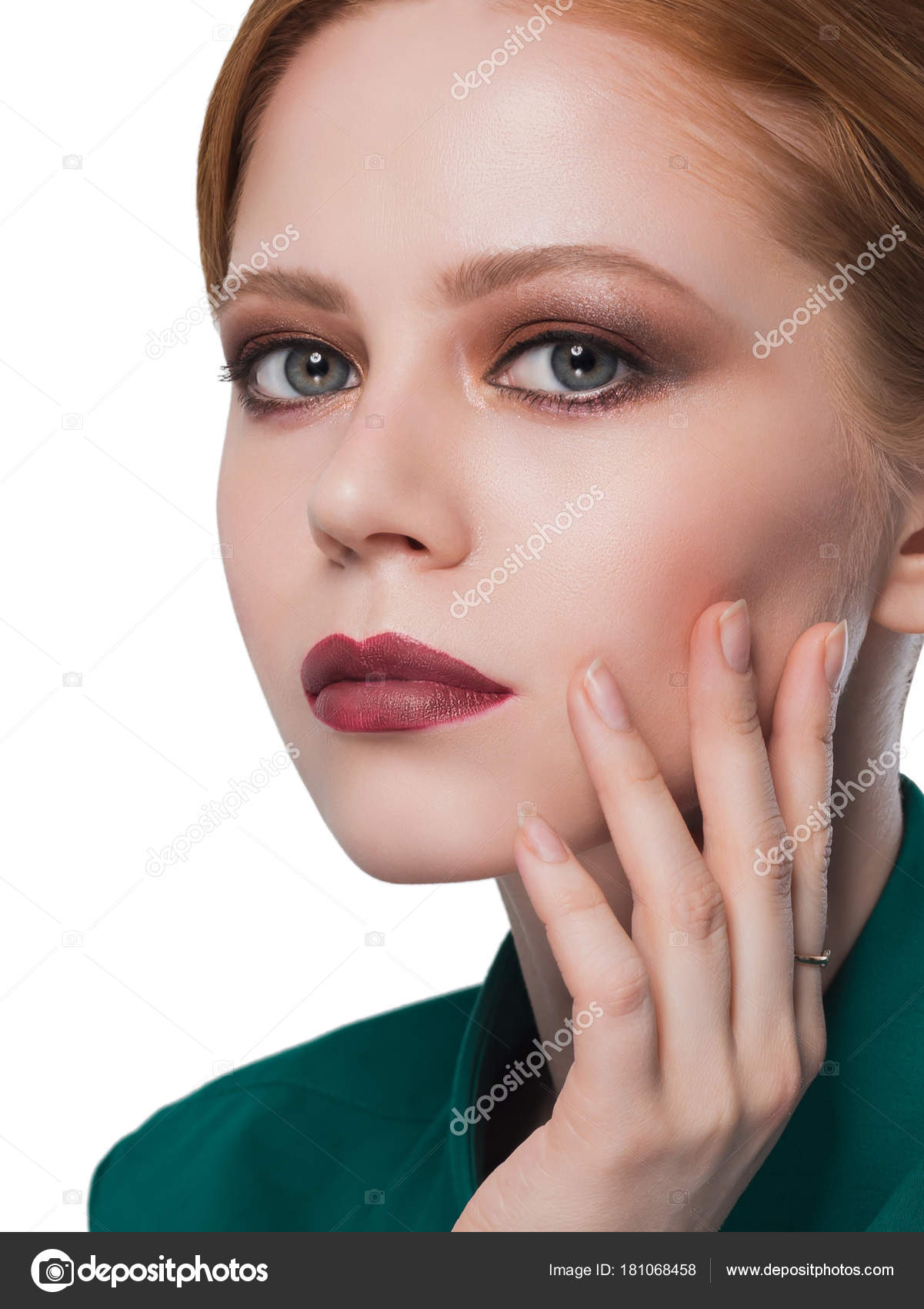 Redhead girl with beautiful makeup hand on my face looking
