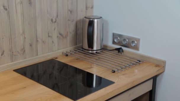 Contemporary hob on a wooden worktop.