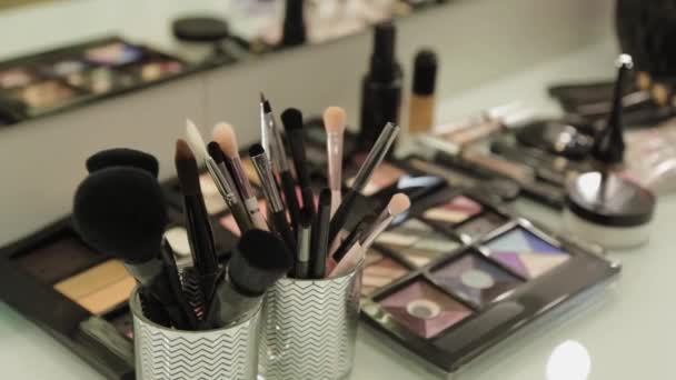 Professional makeup artist tools on a table in a beauty salon.