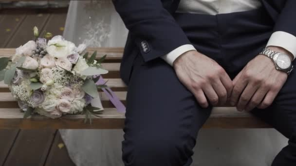 Happy man with a wedding bouquet on a wedding day.