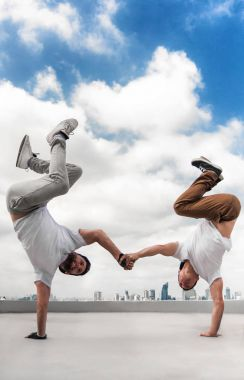 Two Bboy doing stunt at the roof