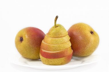 three pears with the  white plate