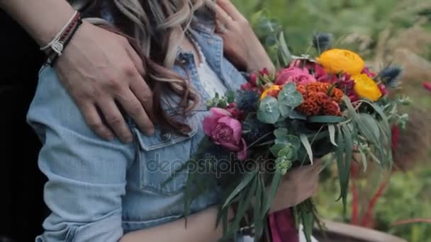 Bride and groom boho-chic wedding style in the forest. bouquet