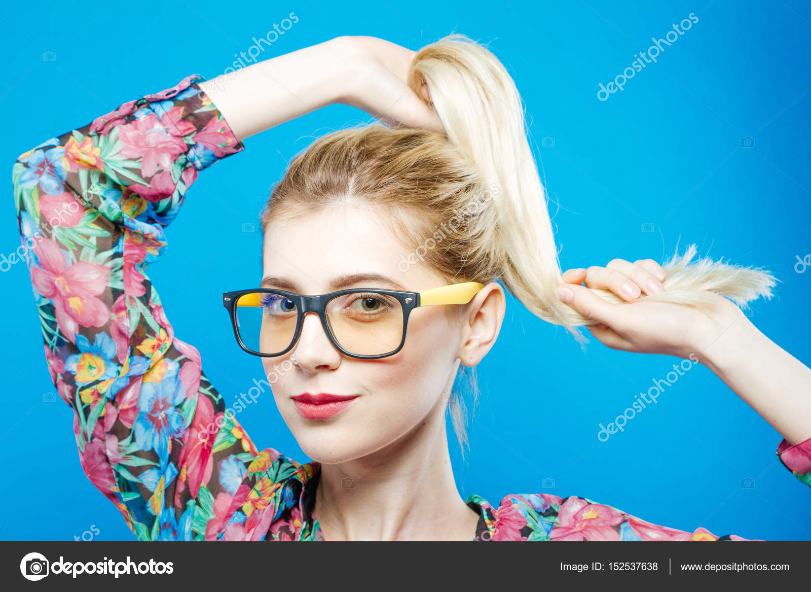 17e98226ce9 Sensual Cute Girl in Fashionable Eyeglasses is Posing in Studio Looking at  the Camera. Portrait
