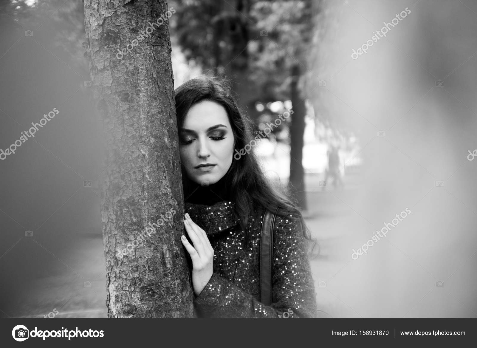 Black and white portrait of attractive woman with sensual lips and professional makeup outdoors stock image