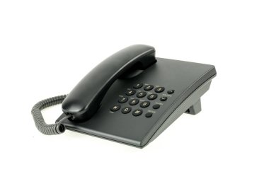 Black office phone with handset on-hook isolated on the white background