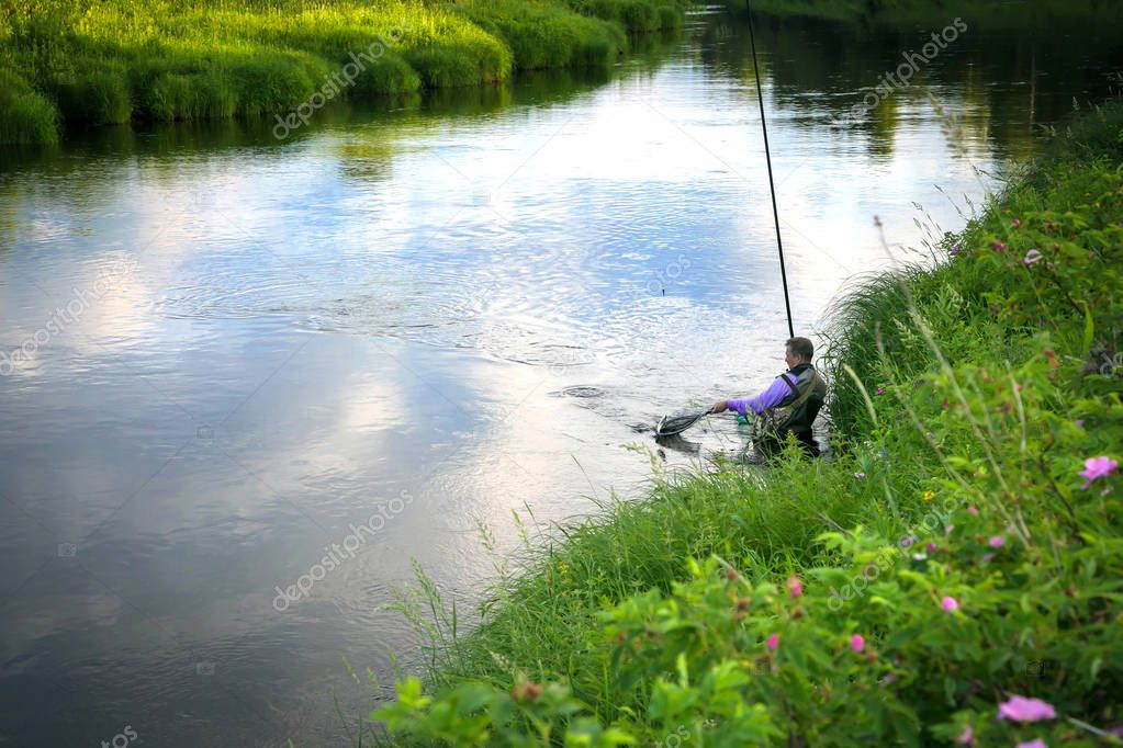 Fisherman caught fish on the river in the countryside.