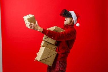 santa claus with gift box on red background