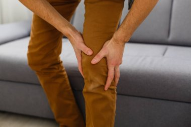 Pain in the knee. A man clings to his leg, a meniscus.