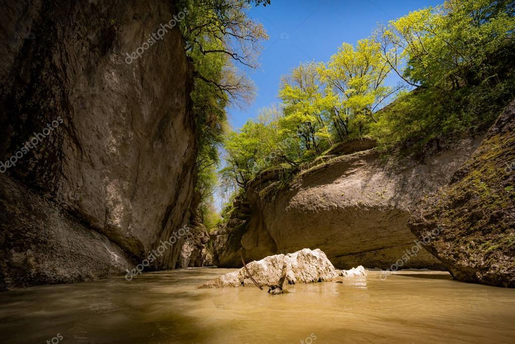 Rock in mountains lake