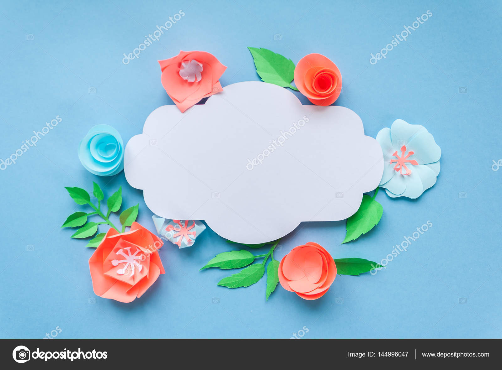 Vintage frame with color paper flowers on the blue background flat vintage frame with color paper flowers on the blue background flat lay nature concept mightylinksfo