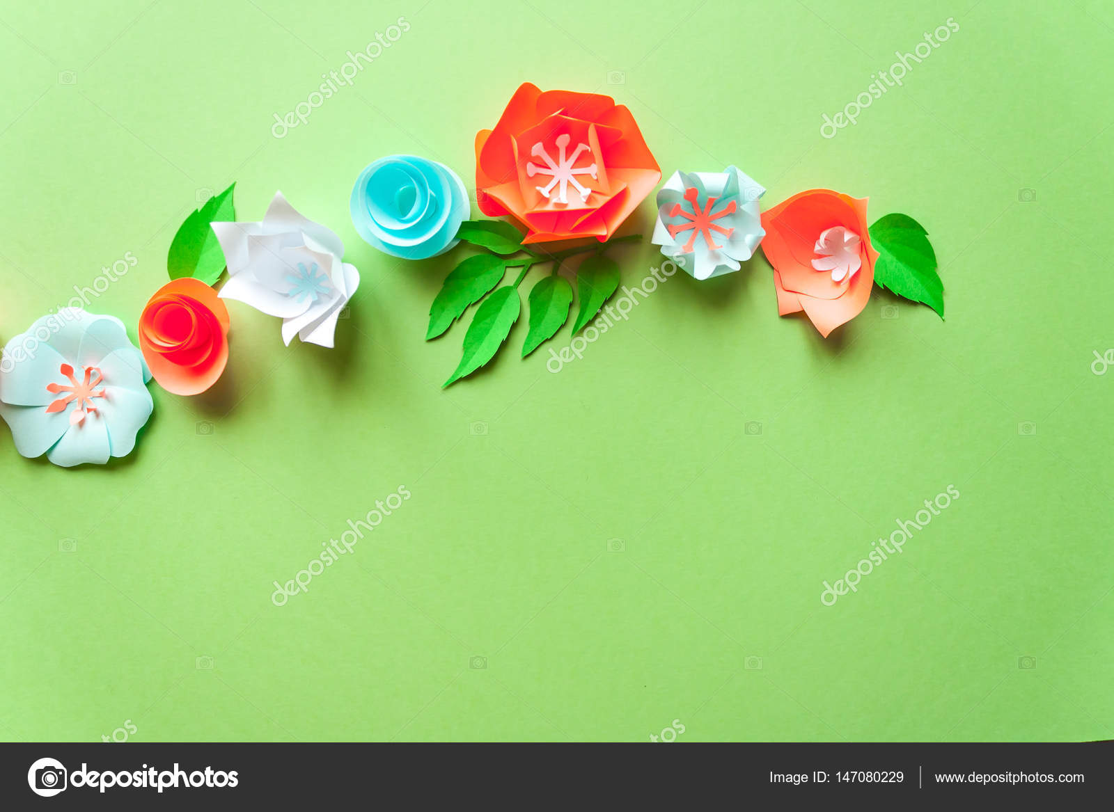 Frame With Color Paper Flowers On The Green Background Flat Lay