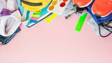 stationery flat lay on pink background