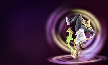 Modern style dancer in jump