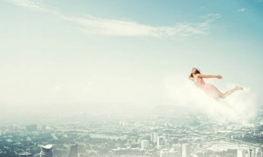 woman flying high in blue sky