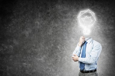 Pensive businessman with lamp head