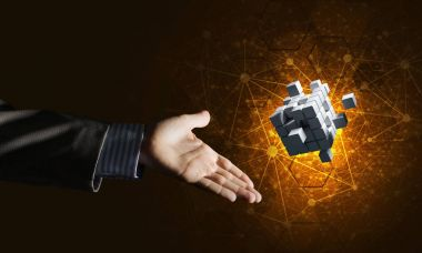 male hand pointing at cube figure