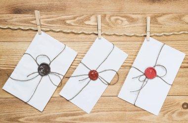 Envelopes hanging on rope