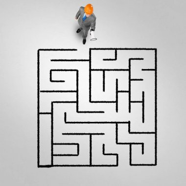 businessman against maze drawn on floor