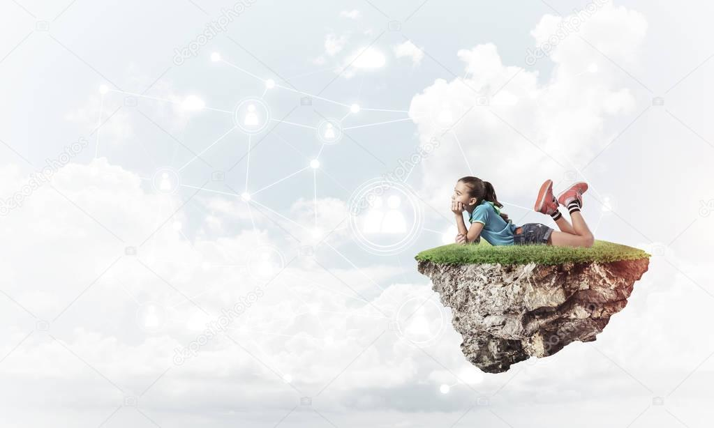 Cute girl lying on floating island with social connection concept on sky background