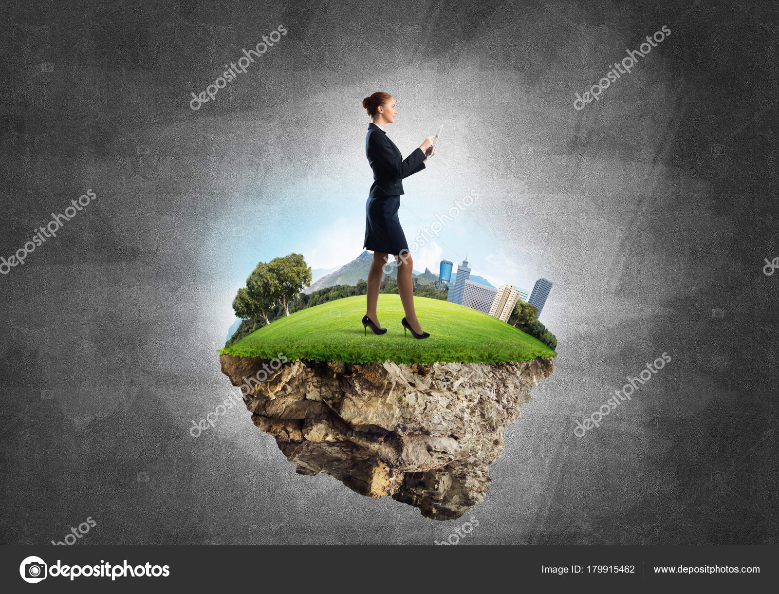 Businesswoman Standing On Green Floating Island Stock Photo