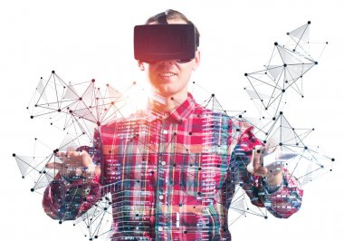 Young man wearing VR goggles and gaming in interactive game. Guy in checkered shirt manipulating virtual network system. Digital entertainment in cyberspace. Future technologies and new experience