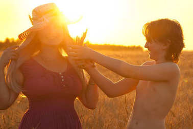mother and child in the sunset wheat field