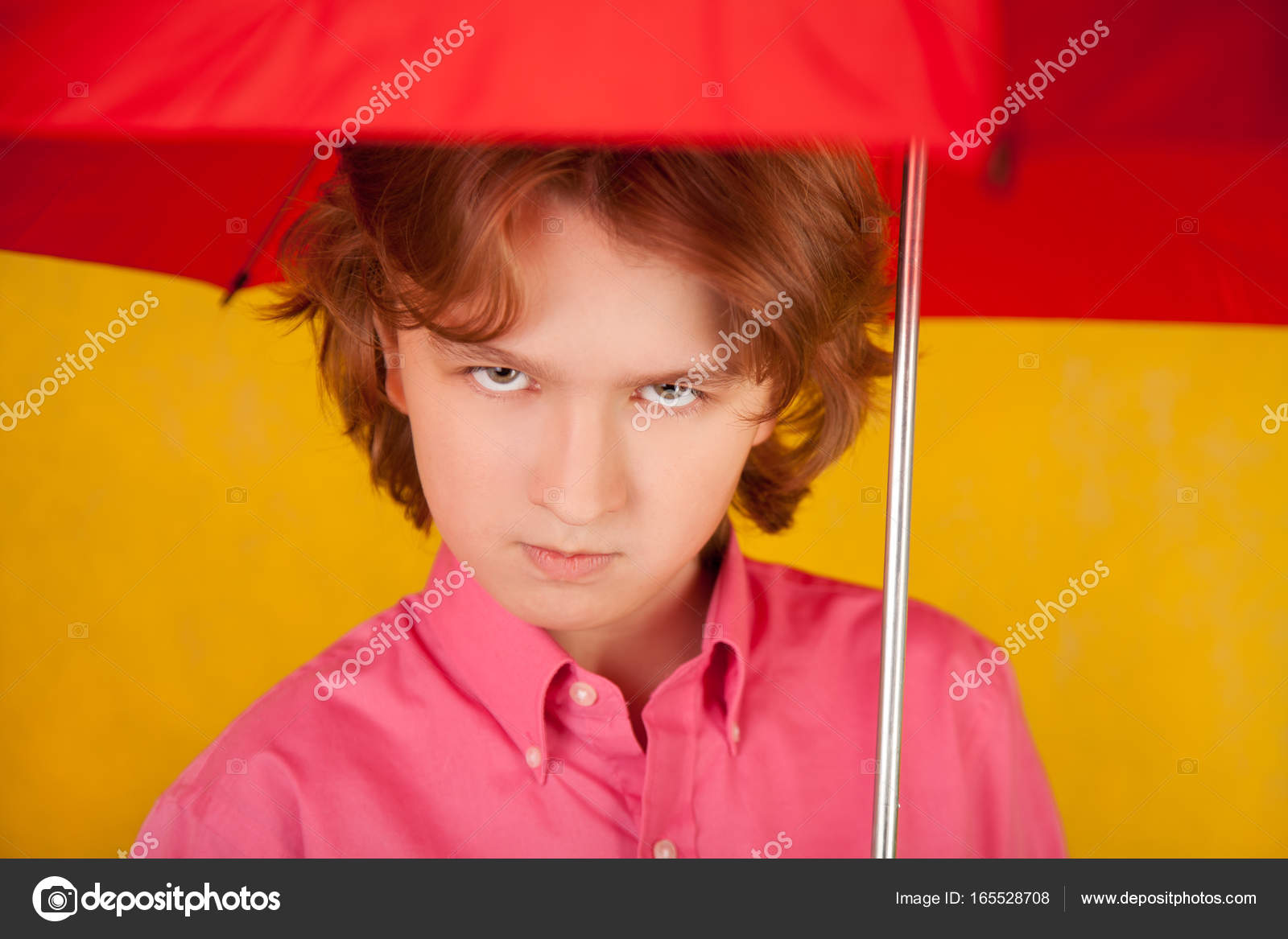 cute kid with red bright umbrella on yellow background alone — stock