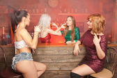 beautiful girls at a bachelorette party in a bar drinking alcohol and having fun