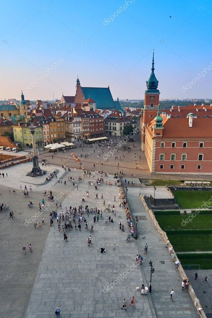 Фотообои Warsaw, Poland - August 11, 2017: Beautiful aerial panoramic view of Plac Zamkowy square in Warsaw, with historic building, including Sigismund III Vasa Column, and people at summer sunset, Warsaw, Po