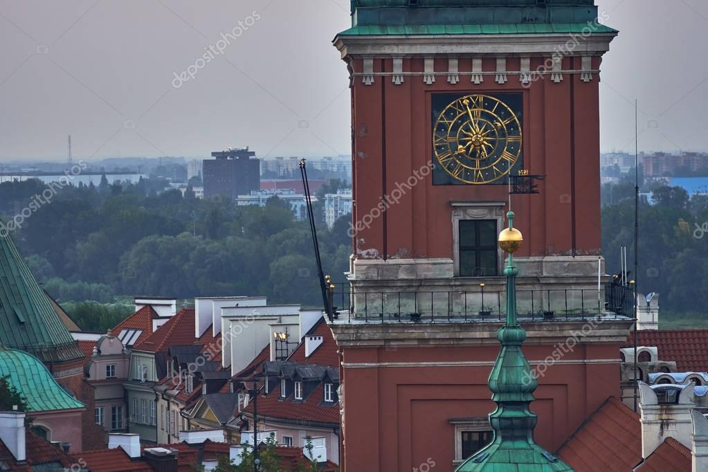 Фотообои Warsaw, Poland - August 11, 2017: Beautiful aerial night panoramic view of clock tower, Plac Zamkowy square in Warsaw, with historic building, including Sigismund III Vasa Column, and people at warm s
