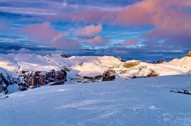 Beautiful panoramic view to the Sellaronda - the largest ski carousel in Europe - skiing the four most famous passes in the Dolomites, Italy; extraordinary snowy peaks of the dolomites, southern alps