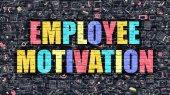 Fotografia Employee Motivation Concept. Multicolor on Dark Brickwall.
