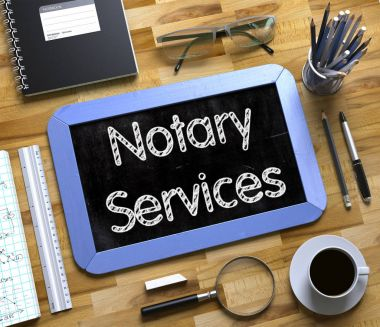 Notary Services - Text on Small Chalkboard. 3d.