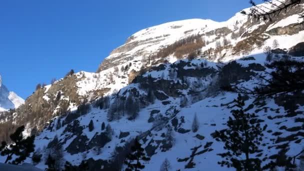 View of Snowy Matterhorn peak in the early spring morning at Zermatt, Switzerland